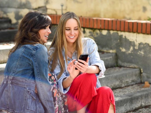 two-women-sharing-social-media-with-smart-phone-CWJQ3T2-thegem-blog-justified Articles & News